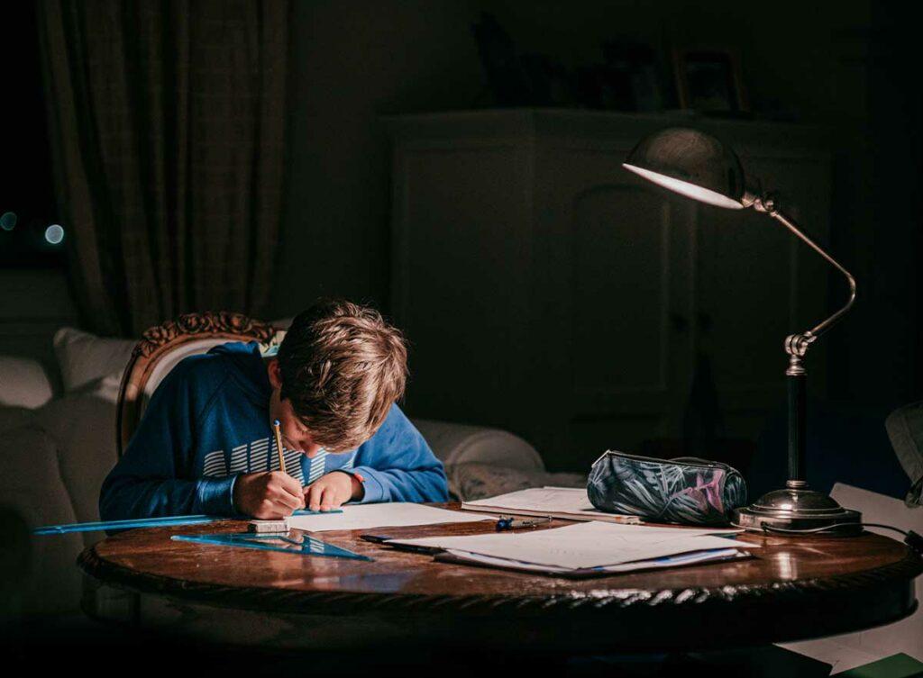child doing homework at night